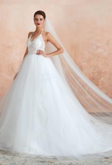 Robe de mariée princesse bustier transparent à bretelles fines