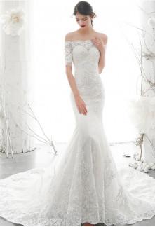 Robe de mariée sirène col bardot manches