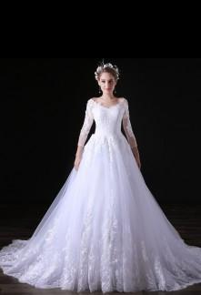 Robe de mariée dentelle raffinée manches