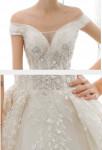 Robe de mariée tulle brodé manches fines