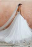 Robe de mariée forme princesse à volants
